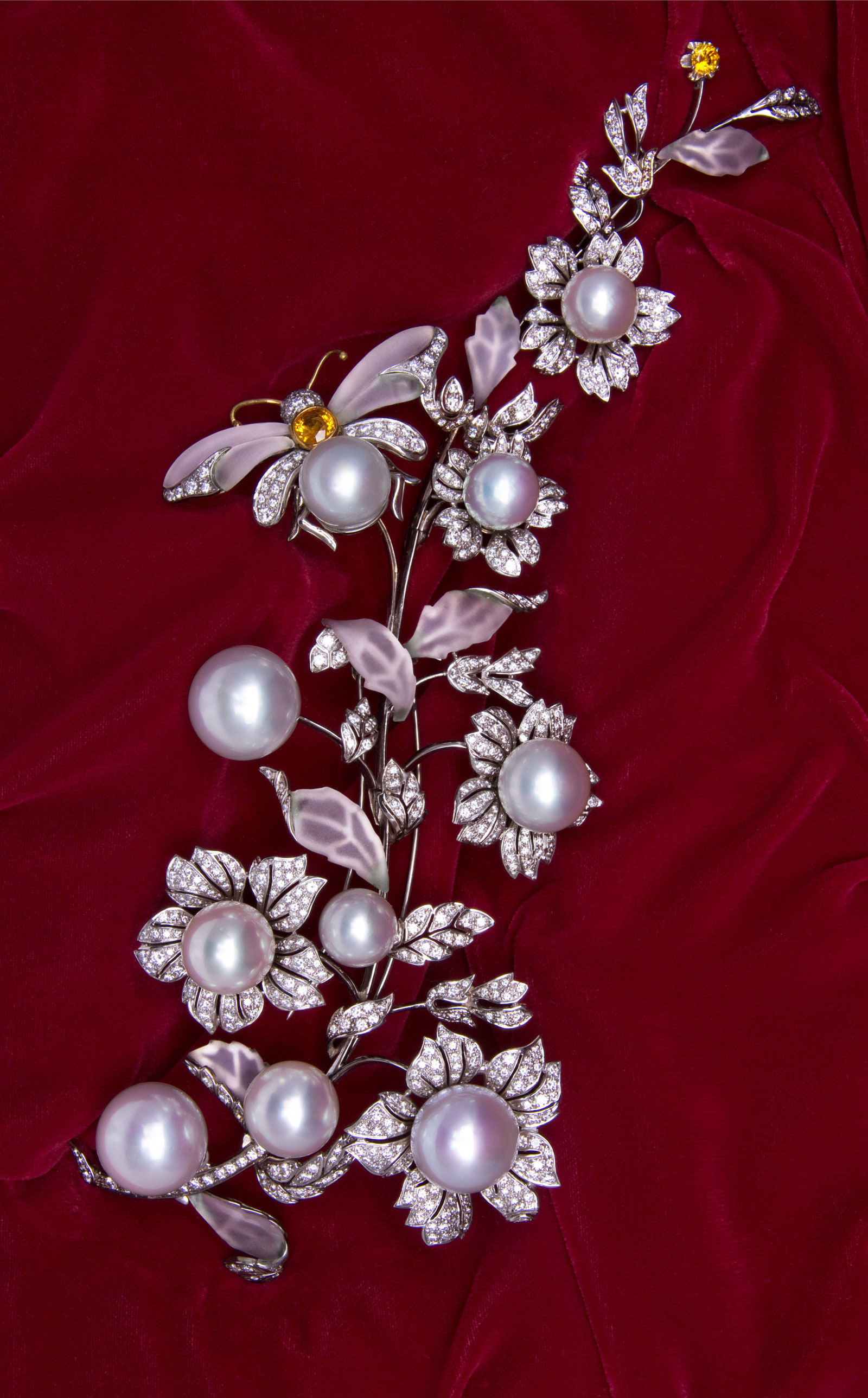 Corsage brooch with 18mm gem quality pearls, diamonds, frosted crystal, and yellow sapphires